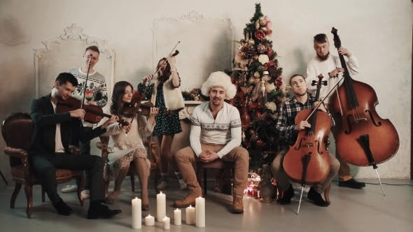 Thumbnail for String Quintet with Singer Starts Playing in Room with Christmas Scenery