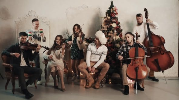 Thumbnail for String Quintet with Vocalist Playing Music in Room with Christmas Decorations