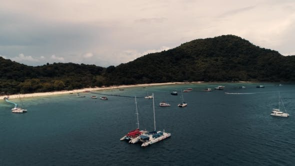 Thumbnail for Thailand Coral Island Drone Shot Small Sports Boats, Large Catamarans, Fishing Schooners