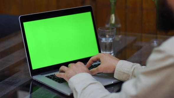 Thumbnail for Man Works on the Laptop with Green Screen