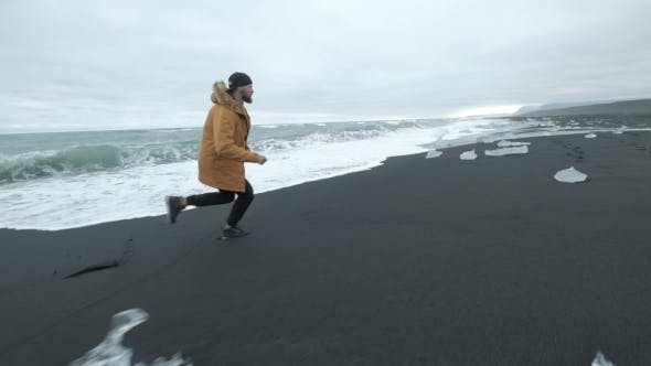 Thumbnail for Running a Man in a Picturesque Natural Landscape on the Running Ocean in Iceland.