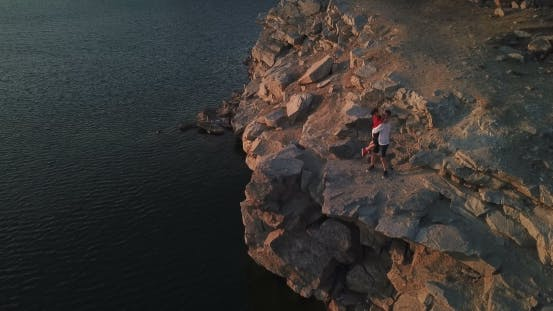 Thumbnail for Son and Father on Rocky Cliff
