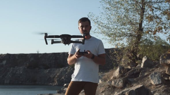 Thumbnail for Man Using Drone on Shore
