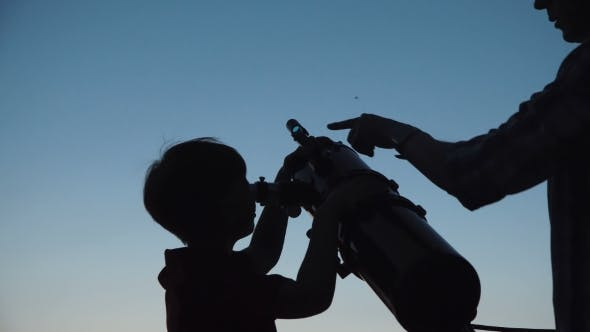 Thumbnail for Man and Boy Using Telescope
