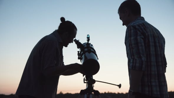 Thumbnail for People Using Telescope in Dawn