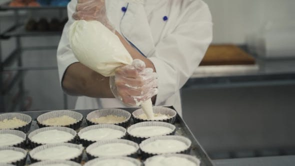 Thumbnail for Female Chef Cook in Rubber Gloves Preparing Vanilla Cake-mix Dough in Form for Baking Cake
