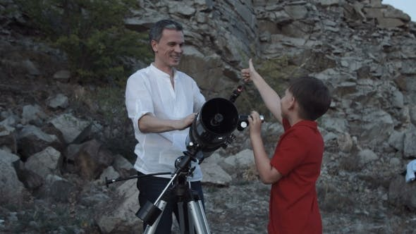 Thumbnail for Father with Son Using Telescope