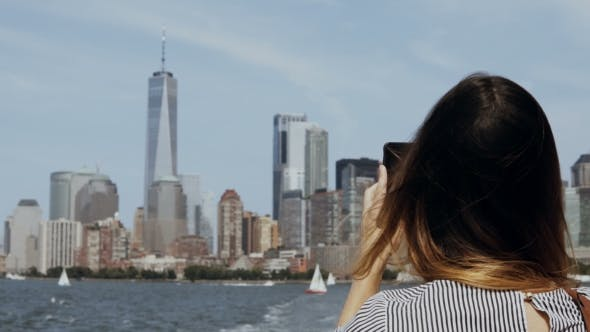 Thumbnail for Young Beautiful Tourist Girl Taking Photos of Manhattan in New York, America on Smartphone