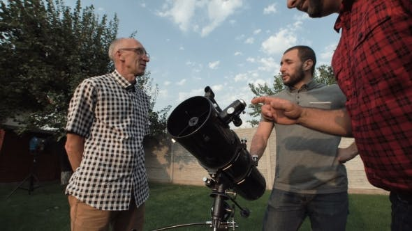 Thumbnail for Men Watching Telescope on Backyard