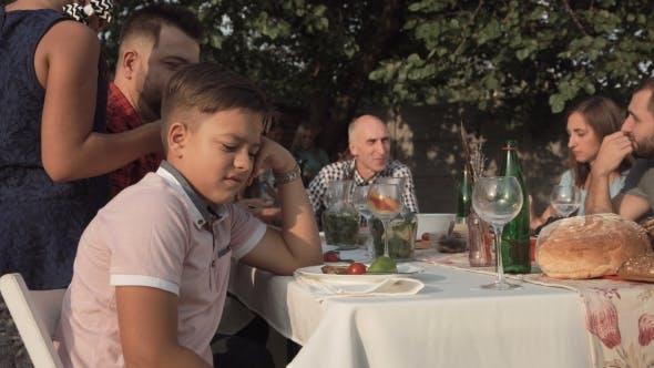 Thumbnail for Annoyed Boy on Family Dinner