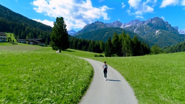 Thumbnail for Woman Jogging Outdoors. Italy Dolomites Alps