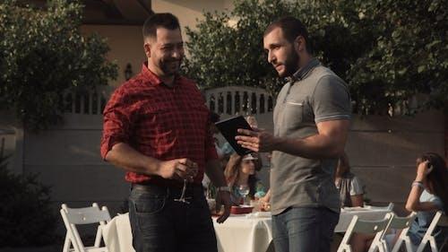 Men Communicating on Backyard