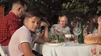 Annoyed Boy on Family Dinner