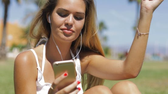 Thumbnail for Charming Girl with Phone and Headphones