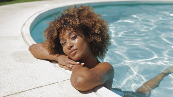Thumbnail for Young Girl Posing in Water of Pool