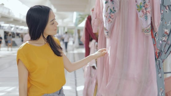 Thumbnail for Girl Exploring Clothing in Mall