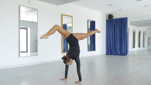 Thumbnail for Woman Performing Gymnastics Exercise
