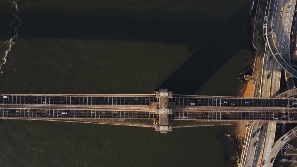 Cover Image for Aerial View of Brooklyn Bridge Through the East River From the Manhattan To Brooklyn in New York