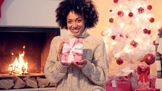 Thumbnail for Beautiful Smiling Woman Holding Xmas Boxed Gift