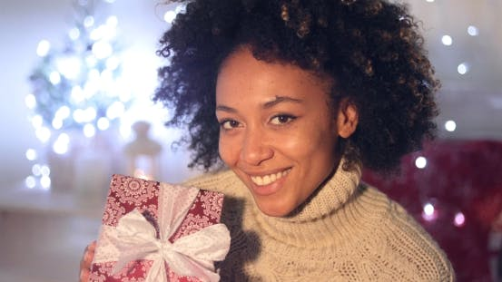 Thumbnail for Woman Holding Christmas Gift with Copy Space