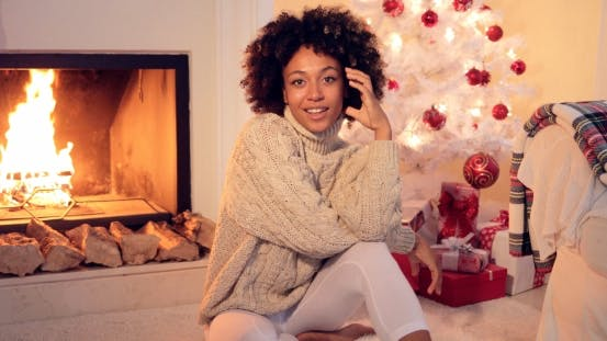 Thumbnail for Woman By Fireplace and White Christmas Tree