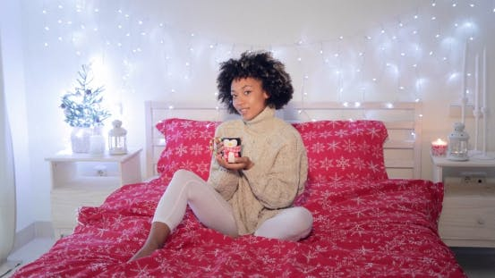 Thumbnail for Happy Young Woman Relaxing with Coffee