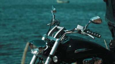 Black Chopper Bike Standing on Blue Sea Shore