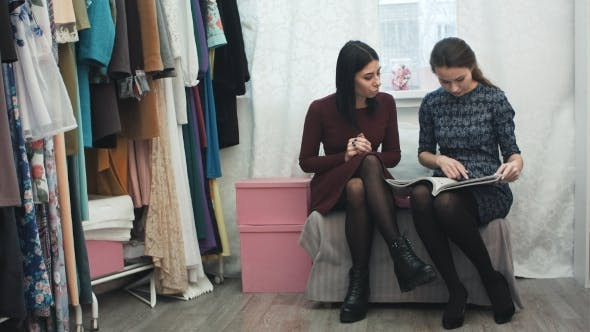 Thumbnail for Beautiful Young Woman in Fashion Atelier Haute Couture Talking with Designer