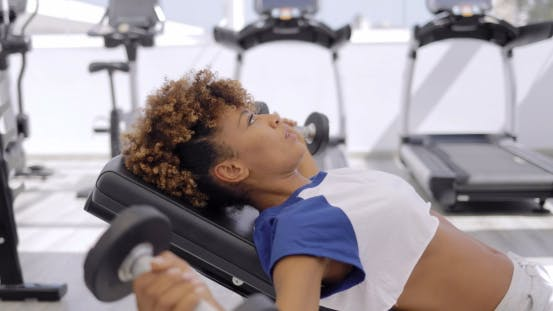 Thumbnail for Concentrated Sportswoman Training with Dumbbells