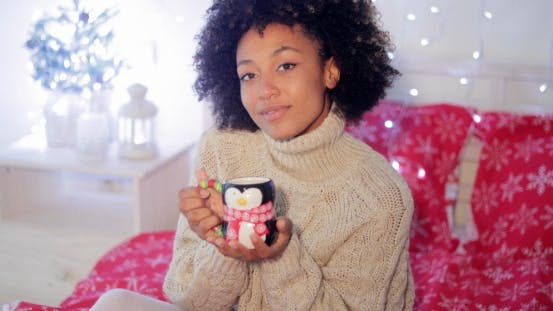 Thumbnail for Smiling Woman Enjoying a Cup of Christmas Coffee