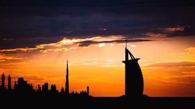 Dubai Cityscape Silhouette on Sunset in UAE