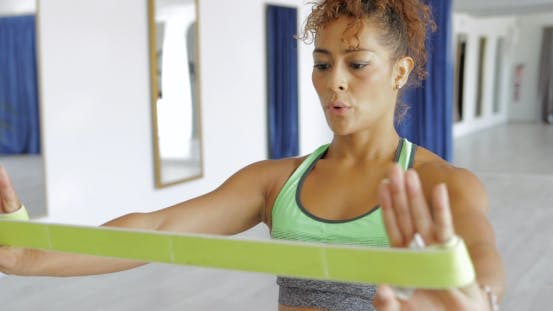 Thumbnail for Sportswoman Training with Elastic Band