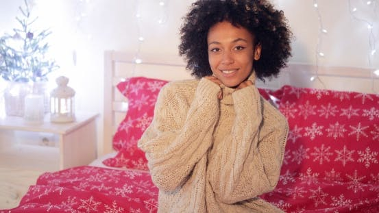 Thumbnail for Pretty Young African Woman in a Christmas Bedroom
