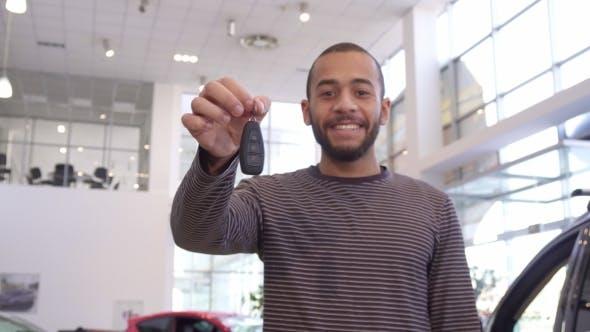 Thumbnail for Man Shows Car Key at the Dealership