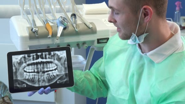 Thumbnail for Dentist Moves the X-ray Image on His Tablet