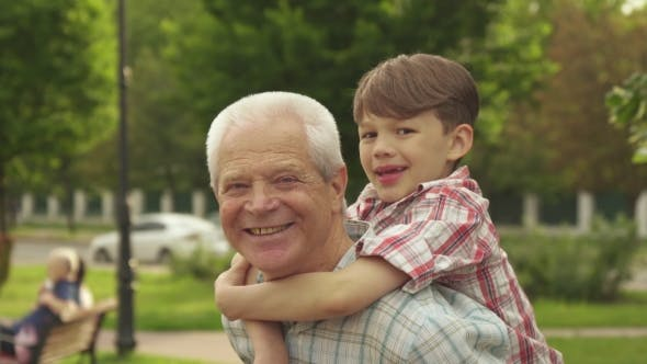 Thumbnail for Little Boy Shows His Thumbs Up on His Grandpa's Back