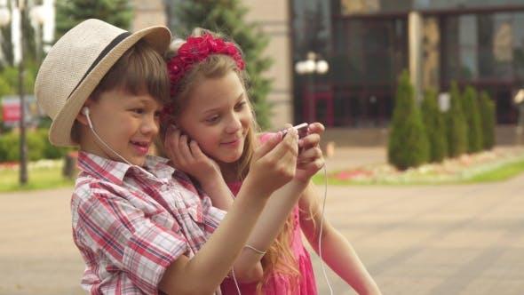Thumbnail for Little Children Take Selfie Outdoors