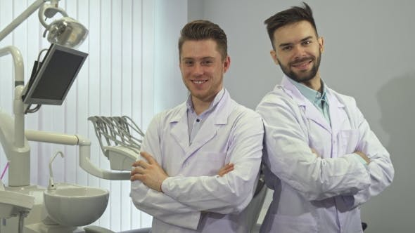 Thumbnail for Two Dentists Show Their Thumbs Up