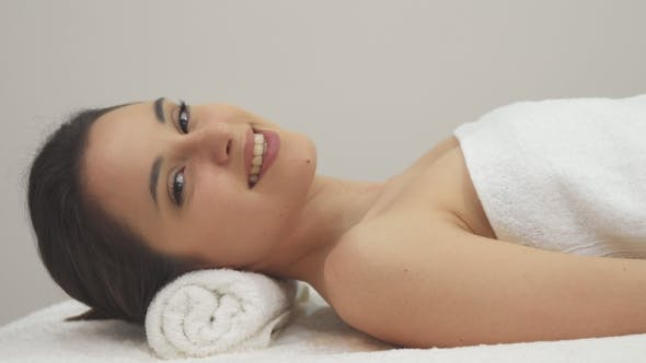 Thumbnail for Girl Poses on the Massage Table
