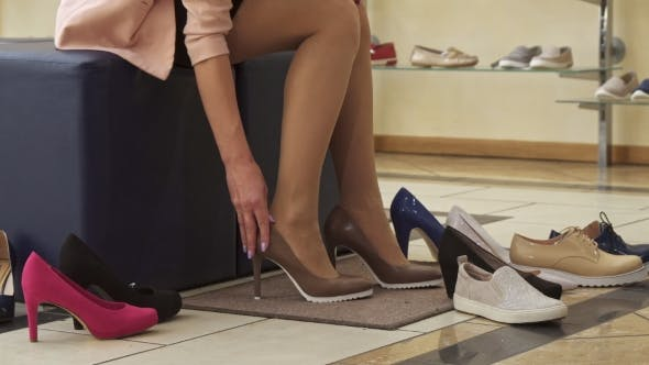 Thumbnail for Girl Puts on Brown Shoes at the Shop