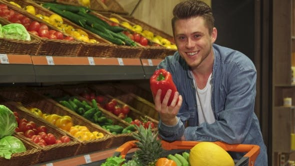 Thumbnail for Man Examines Bell Pepper at the Supermarket