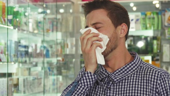 Thumbnail for Man Coughing and Sneezing in Drugstore