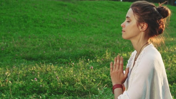Thumbnail for Girl Is Doing Yoga in a Peaceful Atmosphere