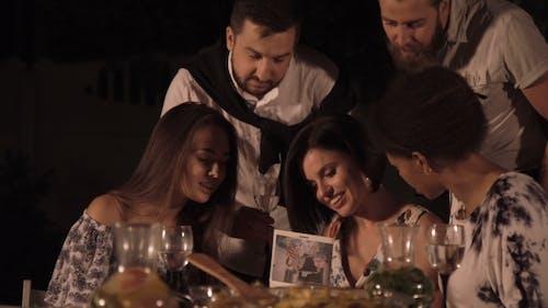 Friends Watching Photo Album Together