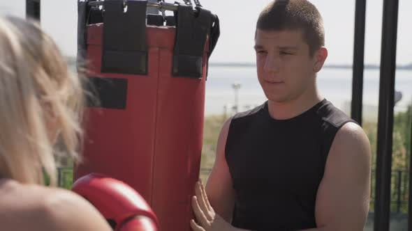 Boxing Coach Teaching Punches