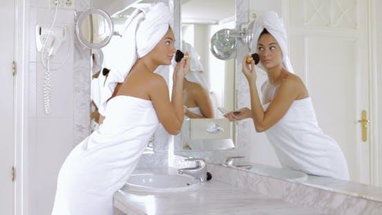 Thumbnail for Woman Applying Makeup in Bathroom