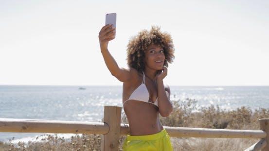 Thumbnail for Content Girl Taking Selfie on Beach