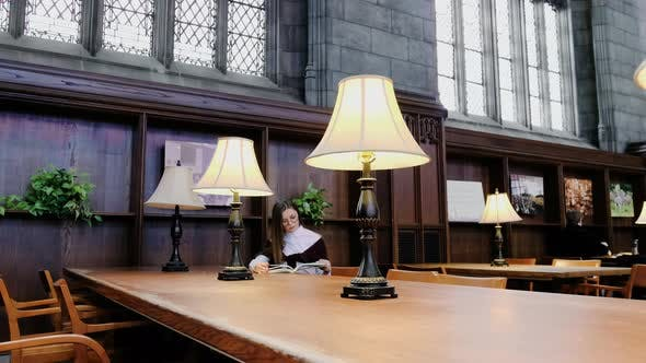 Thumbnail for Girl Sitting at a Big Table in the Library