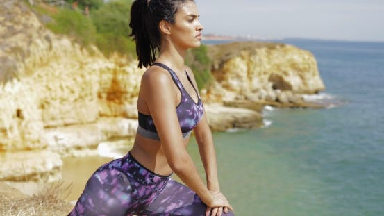 Thumbnail for Determined Sportswoman Stretching on Beach