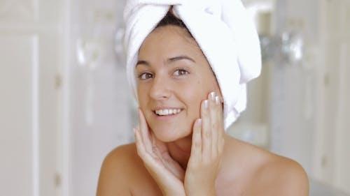 Woman Pampering Skin